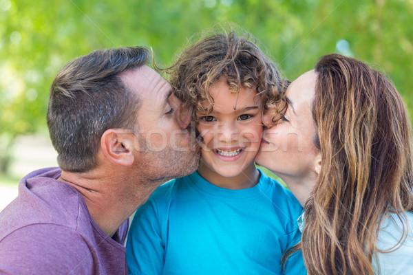 Boldog család csók kamera park napos idő nő Stock fotó © wavebreak_media