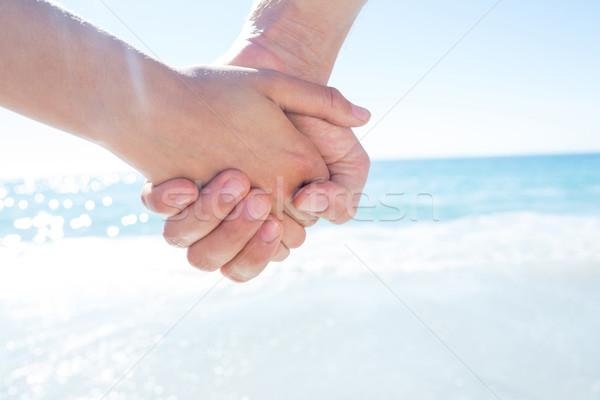 Pareja caminando mano playa mujer hombre Foto stock © wavebreak_media