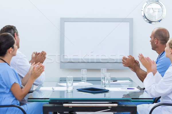 Stock photo: Team of doctor applauding during meeting