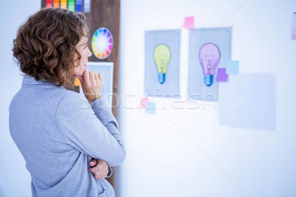 Thoughtful creative businesswoman looking away  Stock photo © wavebreak_media