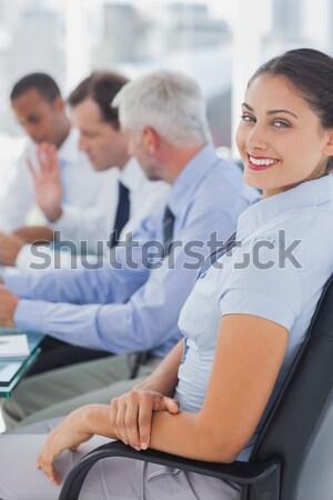 Mujer silla de ruedas sonriendo cámara equipo detrás Foto stock © wavebreak_media