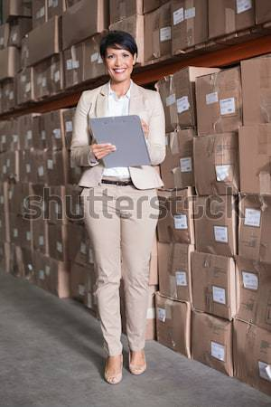 Serious manager with arms crossed in warehouse Stock photo © wavebreak_media