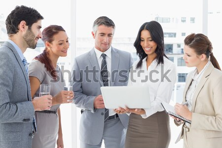 Smiling businessman with work colleagues Stock photo © wavebreak_media