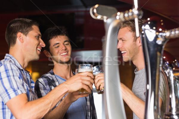 Boldog barátok pirít sör bár kommunikáció Stock fotó © wavebreak_media