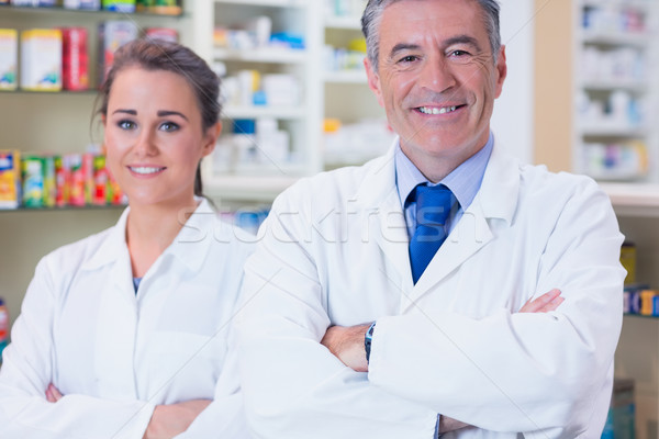 Smiling pharmacist and his trainee with arms crossed Stock photo © wavebreak_media