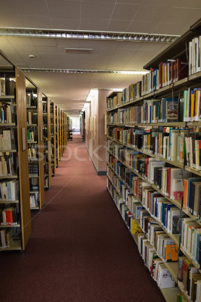 Stock photo: Volumes of books on bookshelf in library