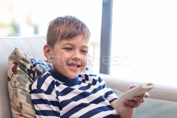 Little boy watching tv on the couch Stock photo © wavebreak_media