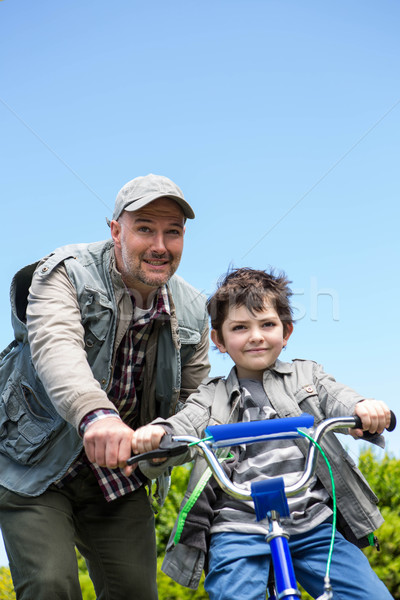 Father and son on a bike ride Stock photo © wavebreak_media