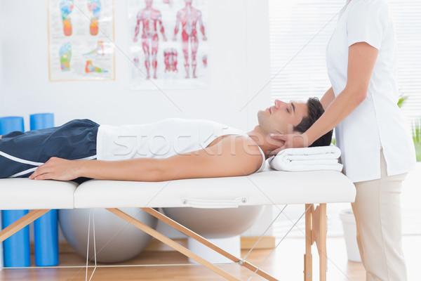 Stock photo: Man receiving neck massage