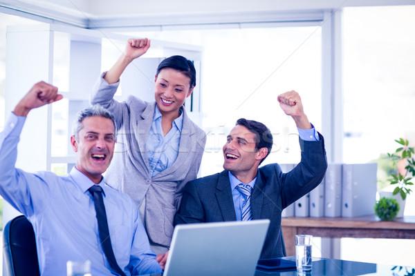 Happy business people cheering together Stock photo © wavebreak_media