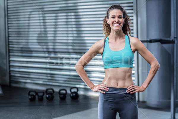 Muscular woman with hands on hips Stock photo © wavebreak_media