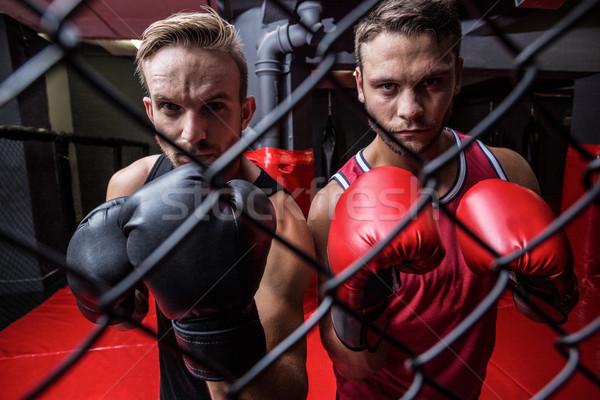 Two boxing men behind the netting Stock photo © wavebreak_media