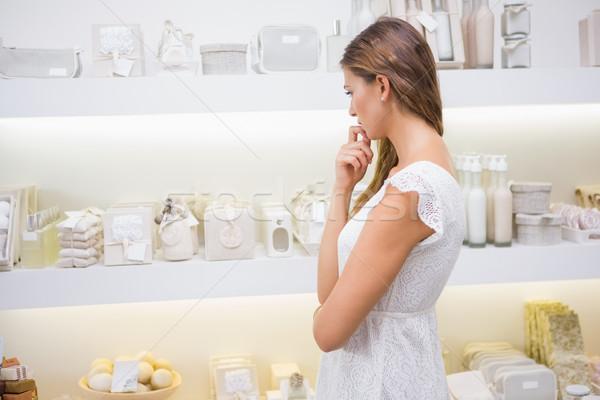 Focused woman browsing products Stock photo © wavebreak_media