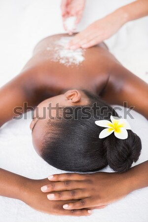 Woman enjoying a salt scrub massage Stock photo © wavebreak_media