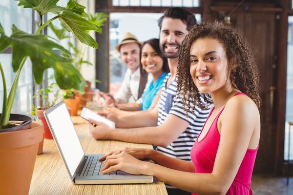 счастливым друзей электронных портрет улыбаясь Сток-фото © wavebreak_media