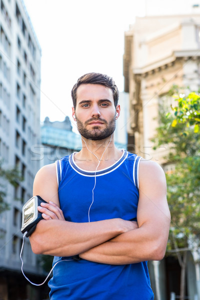 Handsome athlete posing with arms crossed Stock photo © wavebreak_media