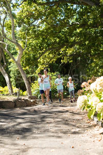 Maraton sportolók fut park határozott nő Stock fotó © wavebreak_media