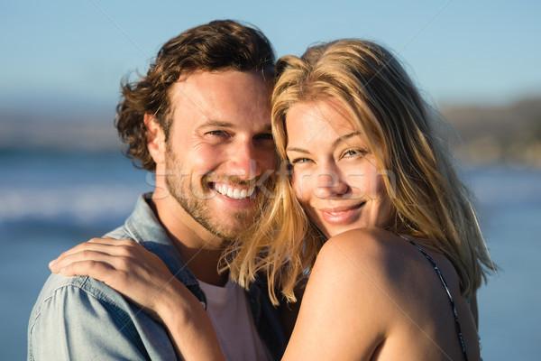 Portrait of happy couple hugging at beach Stock photo © wavebreak_media