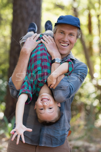 Playful father carrying son while hiking in forest Stock photo © wavebreak_media