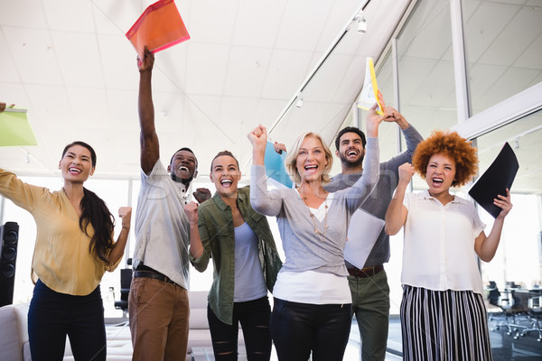 Cheerful business people with arms raised in office Stock photo © wavebreak_media