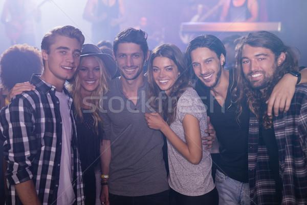 Portrait souriant amis bras autour discothèque Photo stock © wavebreak_media