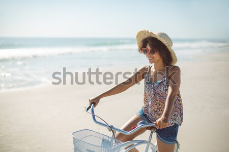 Woman looking away while sitting on shore Stock photo © wavebreak_media