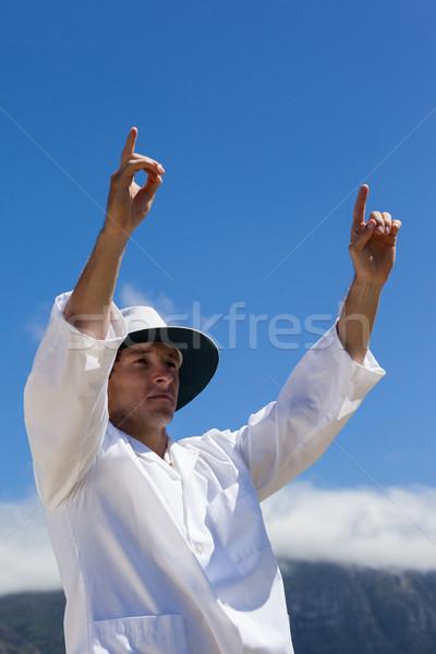 Low angle view of cricket umpire signalling six runs against blue sky Stock photo © wavebreak_media