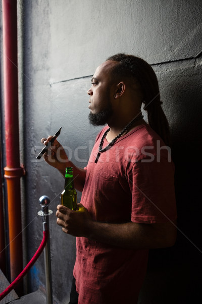 Man smoking electronic cigarette at the entrance Stock photo © wavebreak_media