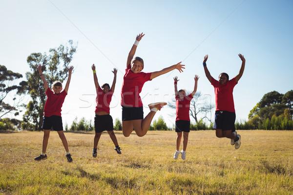 Group of kids having fun in the boot camp Stock photo © wavebreak_media