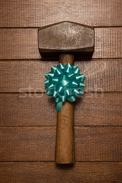 Hammer with ribbon on table Stock photo © wavebreak_media
