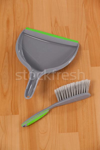 Dustpan and sweeping brush on wooden floor Stock photo © wavebreak_media