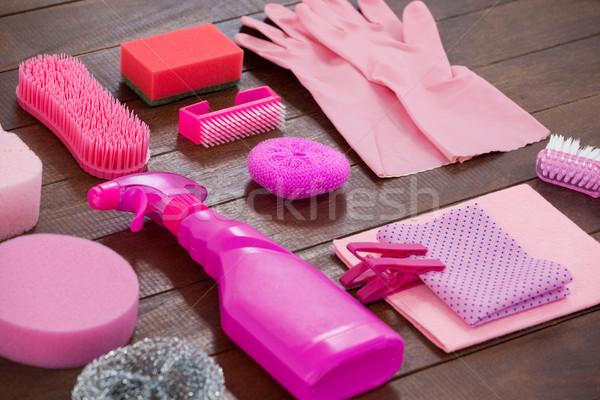 Pink color cleaning equipment arranged on wooden floor Stock photo © wavebreak_media