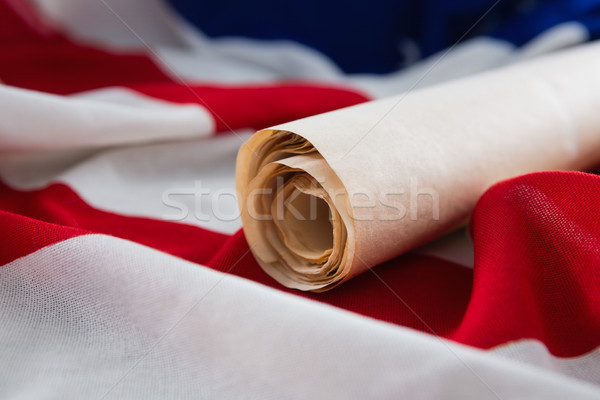 American flag with rolled-up of constitution document Stock photo © wavebreak_media