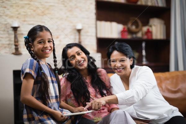 Portrait of happy multi-generation family using digital tablet at home Stock photo © wavebreak_media