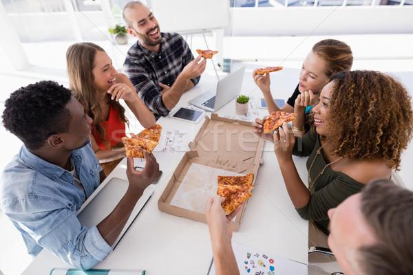 Group of executives interacting while having pizza Stock photo © wavebreak_media