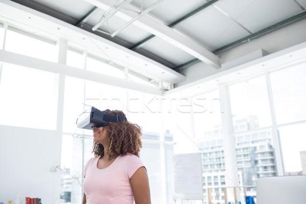 Female executive using virtual reality headset Stock photo © wavebreak_media