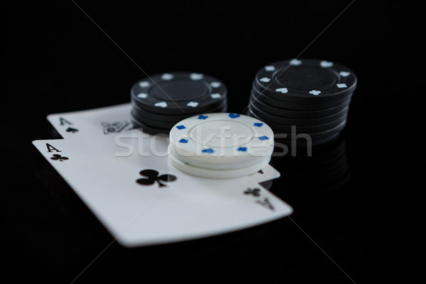 Stock photo: Close-up of chips and aces