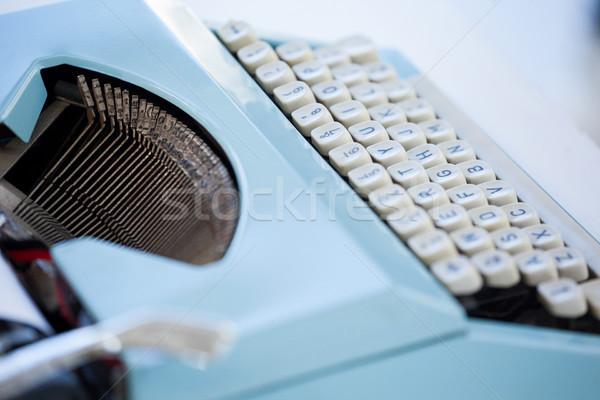 Blauw schrijfmachine bureau hoofdtelefoon witte Stockfoto © wavebreak_media