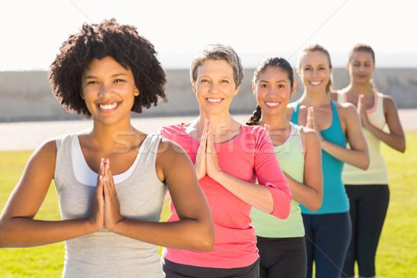 Сток-фото: улыбаясь · женщины · молитвы · положение · йога