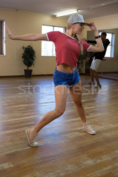 Full length of female dancer with friend rehearsing,in studio Stock photo © wavebreak_media
