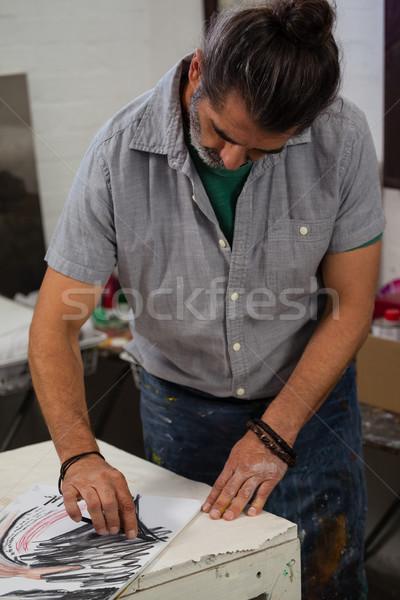 Man sketching in drawing book Stock photo © wavebreak_media
