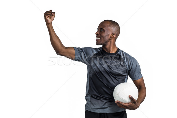 Sportsman with clenched fist holding rugby ball after victory Stock photo © wavebreak_media