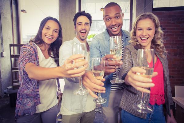 Ritratto felice colleghi champagne ufficio Foto d'archivio © wavebreak_media