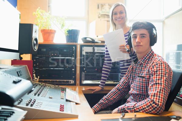 Portrait of male radio host with female employee Stock photo © wavebreak_media