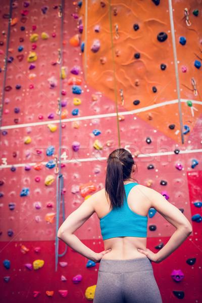 Fit woman looking up at rock climbing wall Stock photo © wavebreak_media