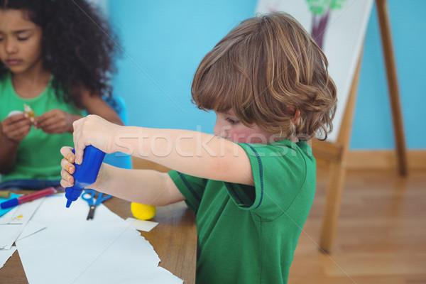 Small boy using arts and crafts supplies Stock photo © wavebreak_media