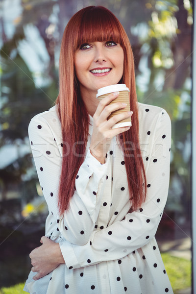Attractive smiling hipster woman with take-away cup Stock photo © wavebreak_media