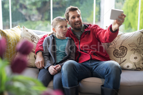 Father and daughter taking a selfie Stock photo © wavebreak_media