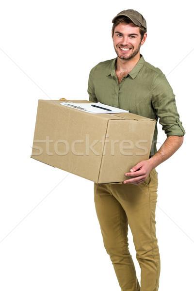 Jóképű postás tart csomag fehér képernyő Stock fotó © wavebreak_media