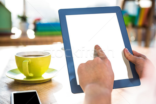 Cropped image of hipster businessman using tablet  Stock photo © wavebreak_media